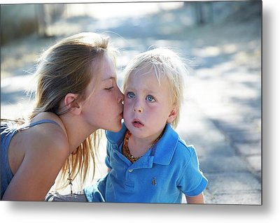 Girl Kissing Brother On Cheek Metal Print by Ruth Jenkinson