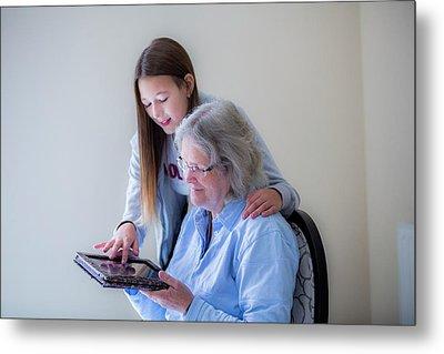 Girl Showing Grandmother Tablet Metal Print by Samuel Ashfield