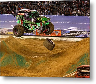 Metal Print featuring the photograph Grave Digger Loses A Wheel by Nathan Rupert