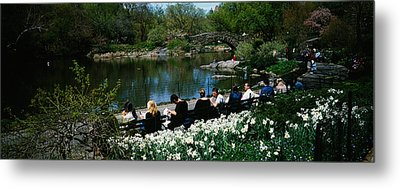 Group Of People Sitting On Benches Metal Print