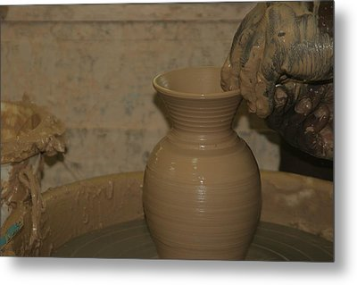 Hands Of The Potter Metal Print by Dervent Wiltshire