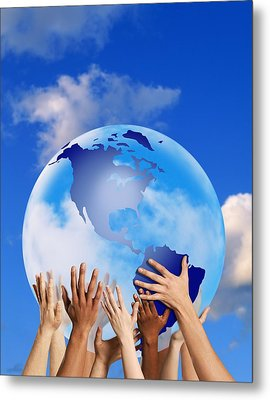 Hands Touching A Globe Metal Print by Don Hammond