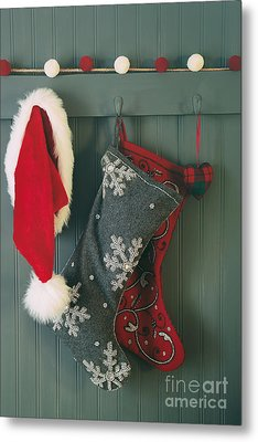 Metal Print featuring the photograph Hanging Stockings And Santa Hat On Hook by Sandra Cunningham