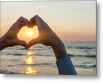 Heart Shaped Hands Framing Ocean Sunset Metal Print by Elena Elisseeva