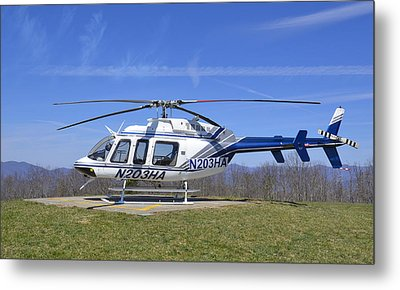 Helicopter On A Mountain Metal Print by Susan Leggett