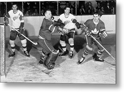 Hockey Goalie Chin Stops Puck Metal Print by Underwood Archives