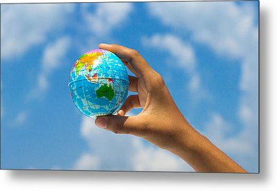 Holding A Globe Metal Print by Aged Pixel