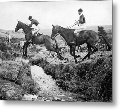 Horses Jumping A Creek Metal Print by Underwood Archives