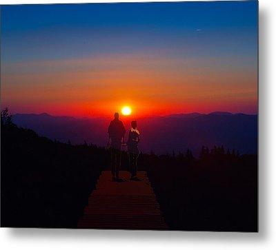 Into The Sunset Together Metal Print by John Haldane