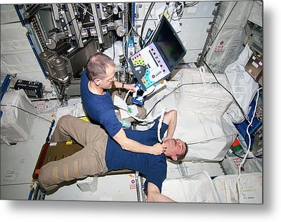 Iss Astronaut Ultrasound Scan Metal Print by Nasa