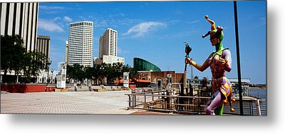 Jester Statue With Buildings Metal Print by Panoramic Images