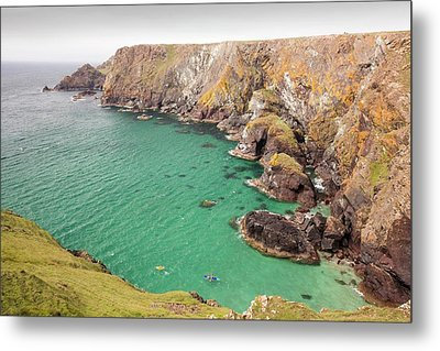 Kayakers In A Cove Near Mullion Cove Metal Print by Ashley Cooper