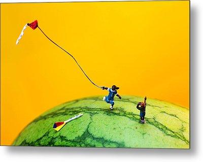 Kite Runner On Watermelon Metal Print by Paul Ge