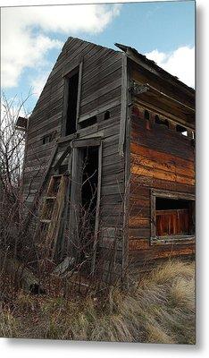 Ladder Against A Barn Wall Metal Print by Jeff Swan