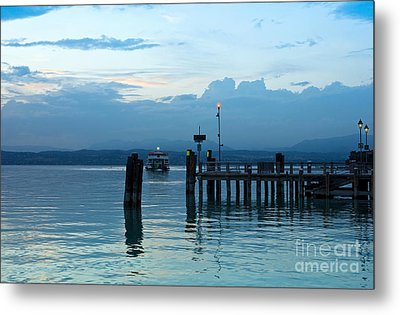 Lake Garda Pier And The Last Ferry For The Day Metal Print by Kiril Stanchev