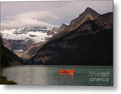 Metal Print featuring the photograph Lake Louise Canoes by Chris Scroggins