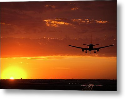 Landing Into The Sunset Metal Print by Andrew Soundarajan