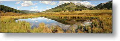 Landscape Of A Mountain Reflected Metal Print by Deb Garside