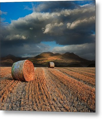 Landscape Of Hay Bales In Front Of Mountain Range With Dramatic  Metal Print by Matthew Gibson