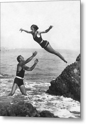 Leap Into Life Guard's Arms Metal Print by Underwood Archives