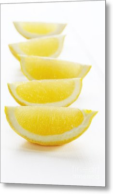 Lemon Wedges On White Background Metal Print by Colin and Linda McKie