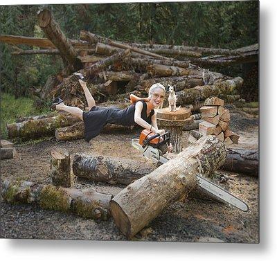 Levitating Housewife - Cutting Firewood Metal Print by Lori Grimmett