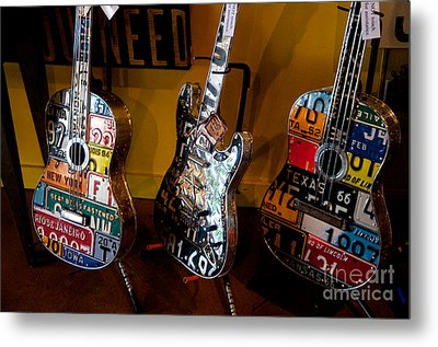 Metal Print featuring the photograph License Plate Guitars by Vinnie Oakes