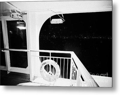 lifebelt on board the hurtigruten ship ms midnatsol at night in winter in Tromso troms Norway Metal Print by Joe Fox