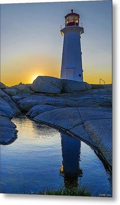Lighthouse At Sunset Metal Print by Ken Morris