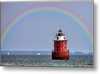 Lighthouse On The Bay Metal Print by Brian Wallace