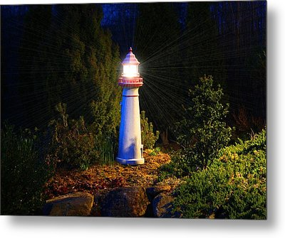 Lit-up Lighthouse Metal Print by Kathryn Meyer