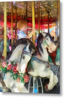 Little Boy On Carousel Metal Print by Susan Savad