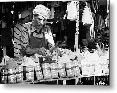 Local Arab Man Measuring Out A Quantity Of Spice For Sale On Stall Of Spices At The Market In Nabeul Tunisia Metal Print by Joe Fox