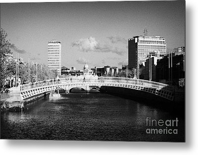 Looking Down The Liffey Towards The Hapenny Ha Penny Bridge Over The River Liffey In Dublin Metal Print by Joe Fox