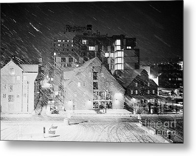 looking out atTromso bryggen quay harbour on a cold snowy winter night troms Norway europe Metal Print by Joe Fox