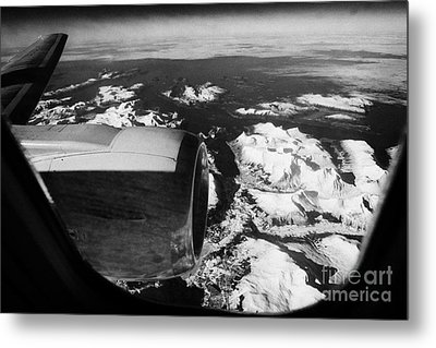 Looking Out Of Aircraft Window Over Engine And Snow Covered Fjords And Coastline Of Norway Europe Metal Print by Joe Fox