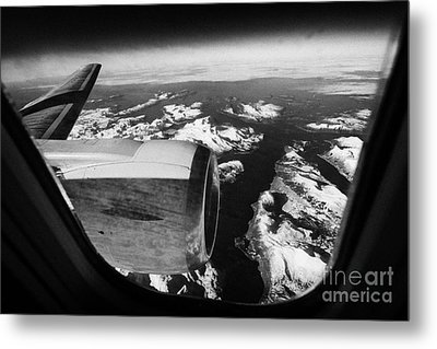 Looking Out Of Aircraft Window Over Snow Covered Fjords And Coastline Of Norway Europe Metal Print by Joe Fox