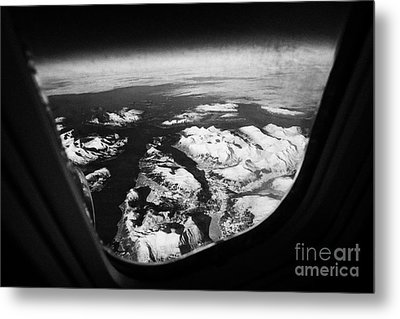 Looking Out Of Aircraft Window Over Snow Covered Fjords And Coastline Of Norway  Metal Print by Joe Fox