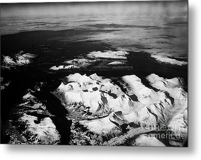 Looking Out Of Aircraft Window Over Snow Covered Fjords And Coastline Of Norway Northern Europe Metal Print by Joe Fox