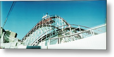 Low Angle View Of A Rollercoaster Metal Print