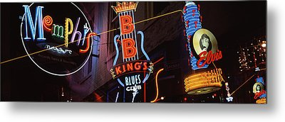 Low Angle View Of Neon Signs Lit Metal Print by Panoramic Images