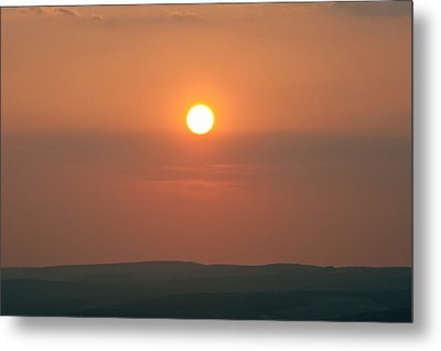 Low Setting Sun Over Distant Landscape Metal Print by Matthew Gibson