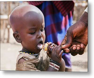 Maasai Child Trying To Eat A Lollipop In Tanzania Metal Print by Michal Bednarek