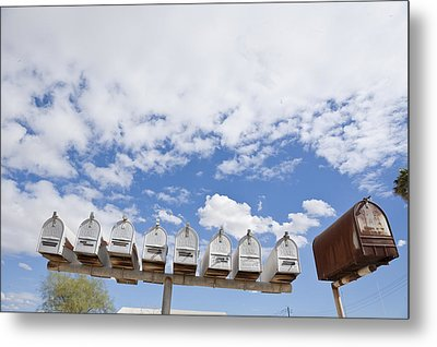 Mailboxes Against Sky Metal Print by David Litschel