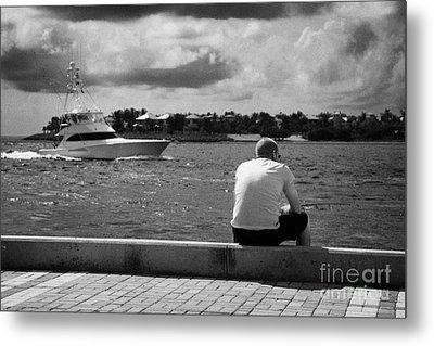 Man Fishing On Mallory Square Seafront Key West Florida Usa Metal Print by Joe Fox