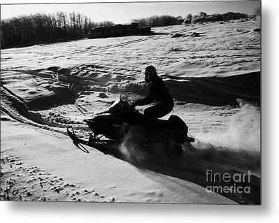 man on snowmobile crossing frozen fields in rural Forget Saskatchewan Metal Print by Joe Fox