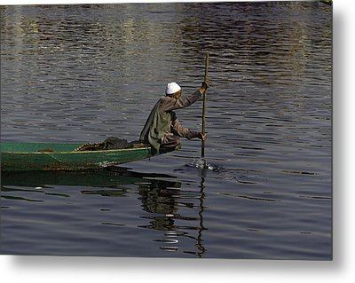 Man Plying A Wooden Boat On The Dal Lake Metal Print