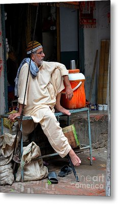 Man Sits And Relaxes In Lahore Walled City Pakistan Metal Print by Imran Ahmed