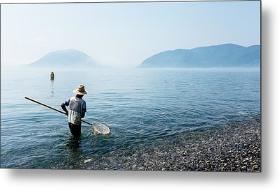 Man With A Net Metal Print