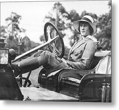 Marion Gaynor At The Wheel Metal Print by Underwood Archives